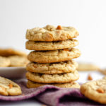 stack of cookies with purple kitchen towel