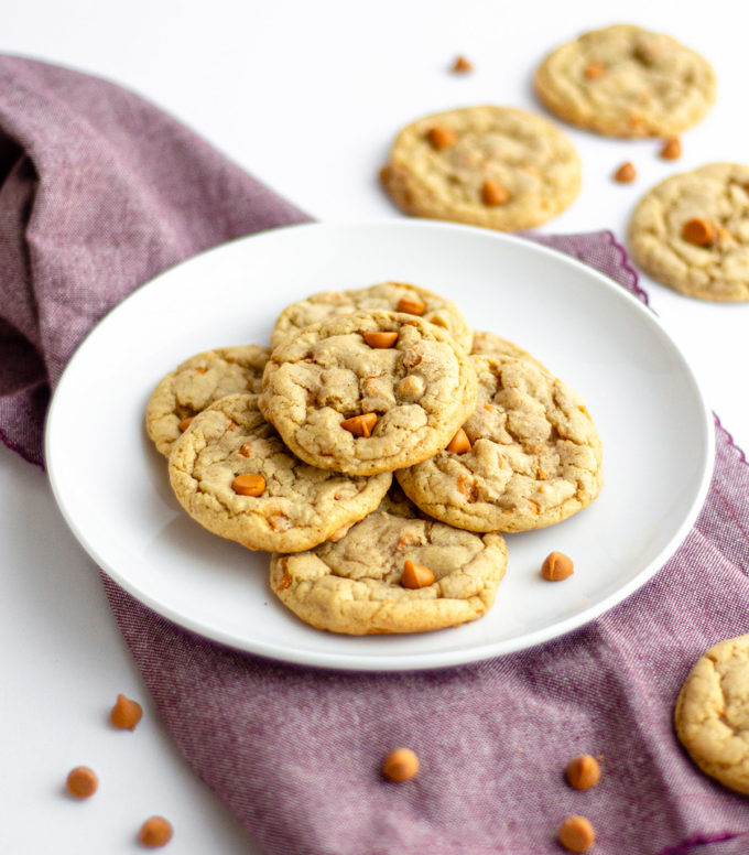 plate of cookies sitting on purple kitchen towel