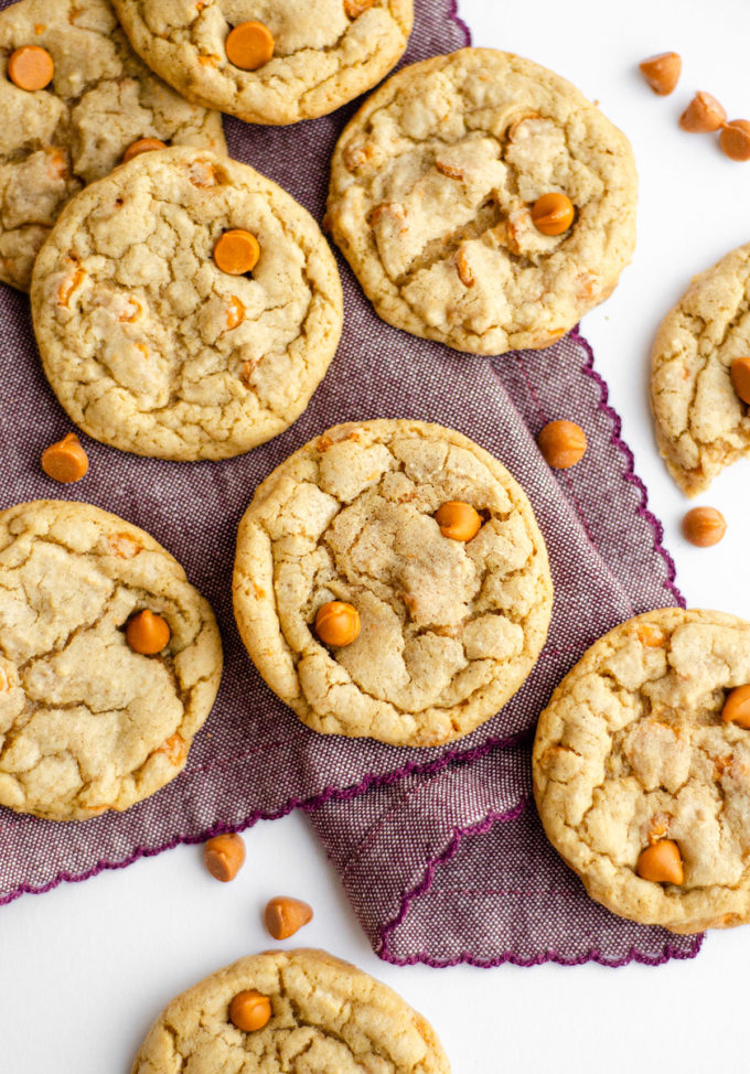 aerial photo of butterscotch chip cookies on purple kitchen towel
