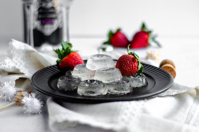 plate of champagne jell-o shots on a plate with strawberries