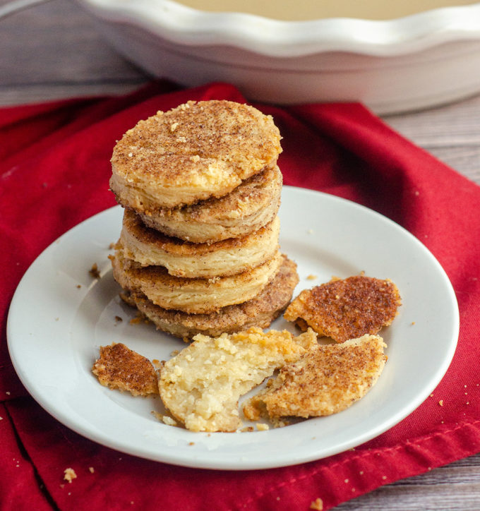 stack of pie crust cookies on a plate with a red napkin