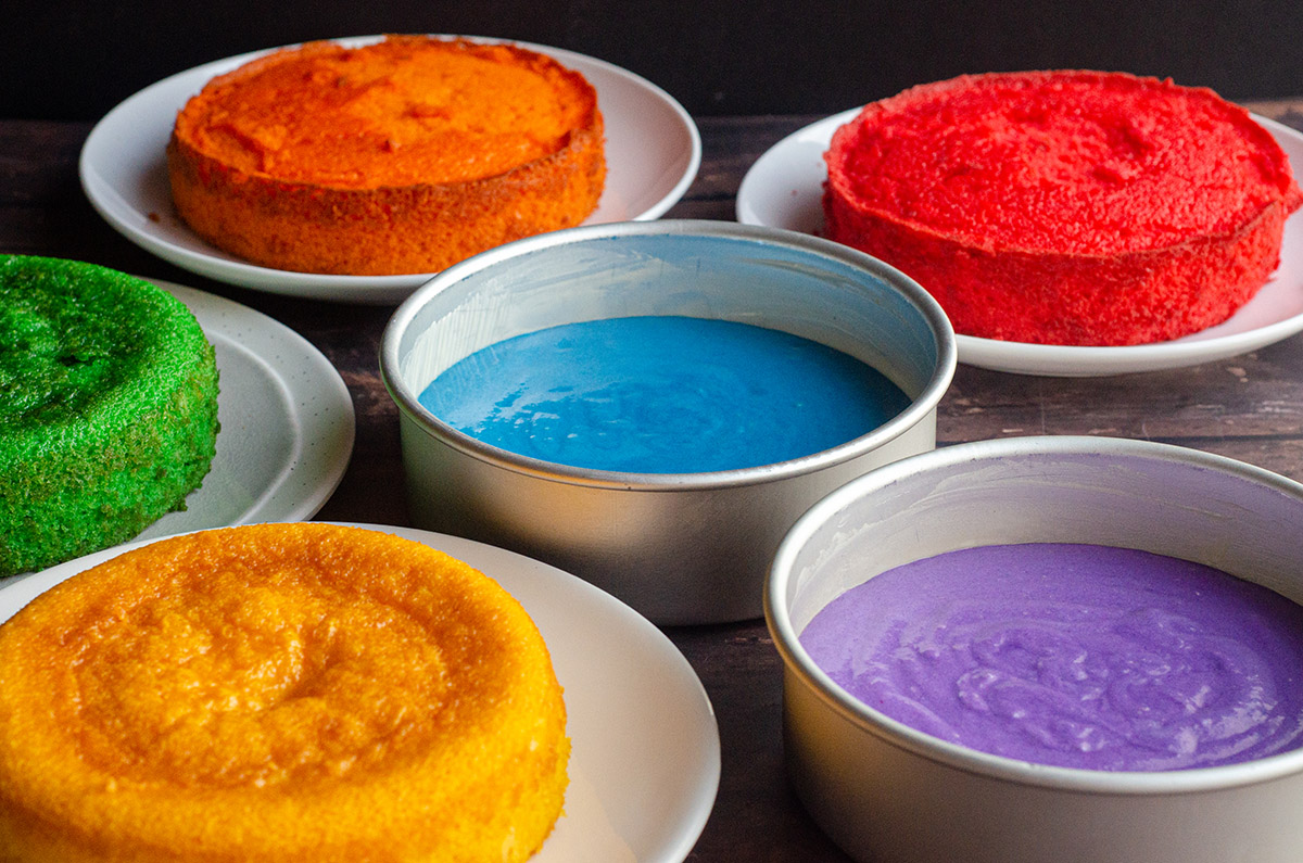 pans filled with batter for a rainbow cake