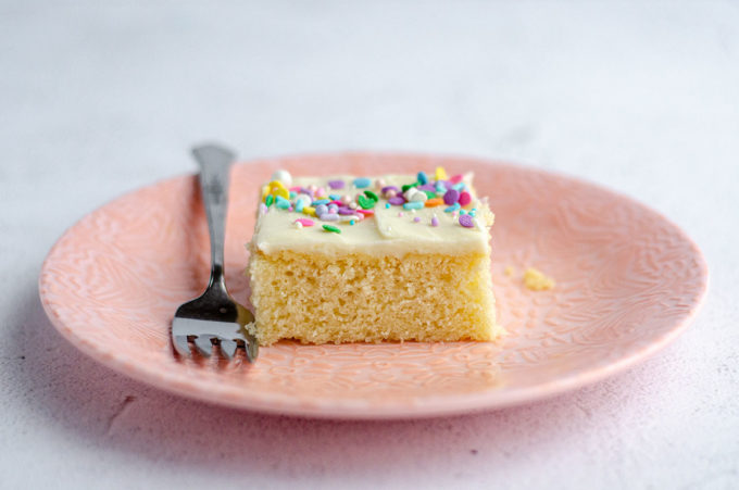 Simple White Sheet Cake: A perfectly moist and simple white cake that pairs with any frosting you prefer.