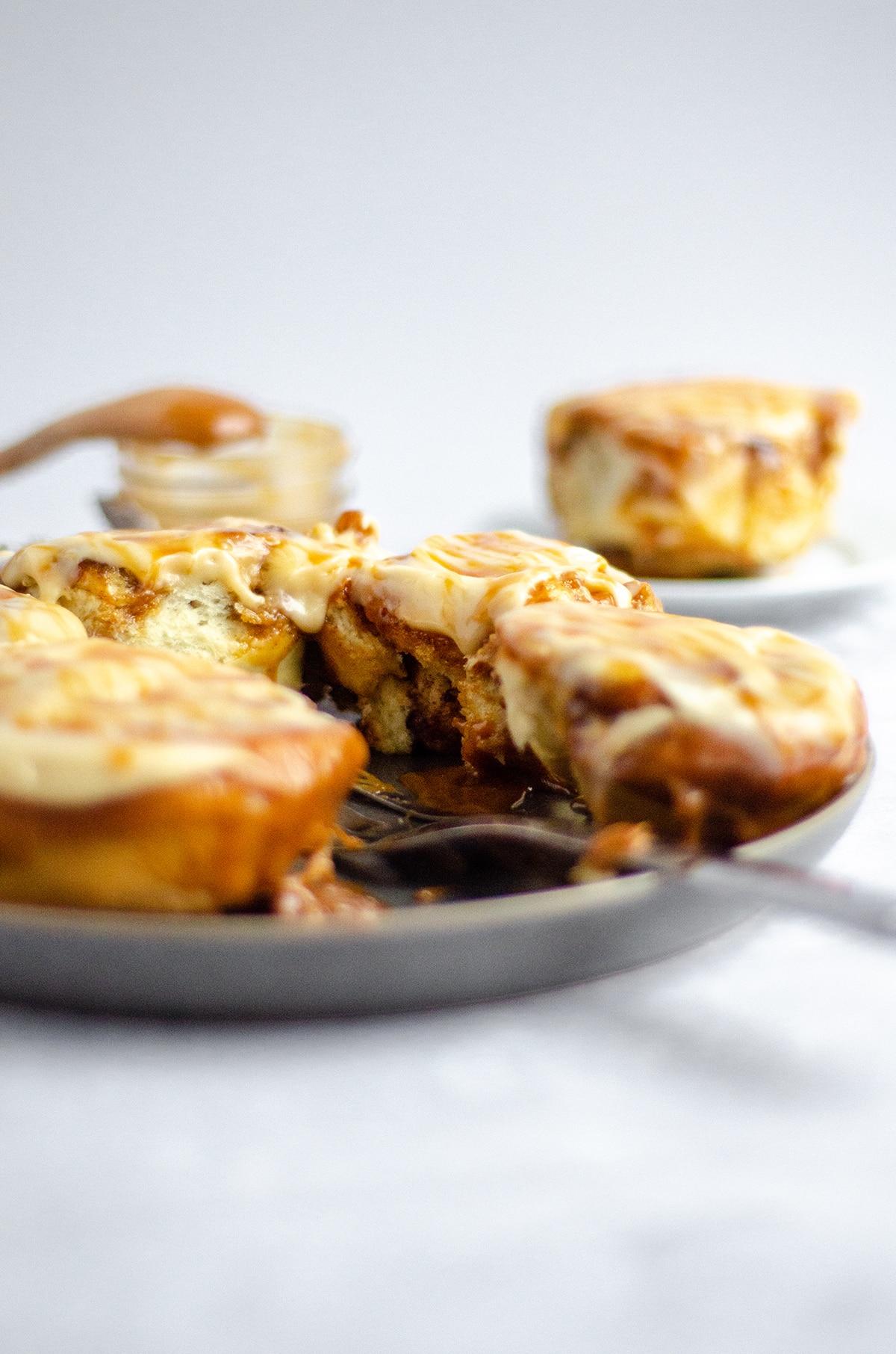 caramel rolls on a serving plate