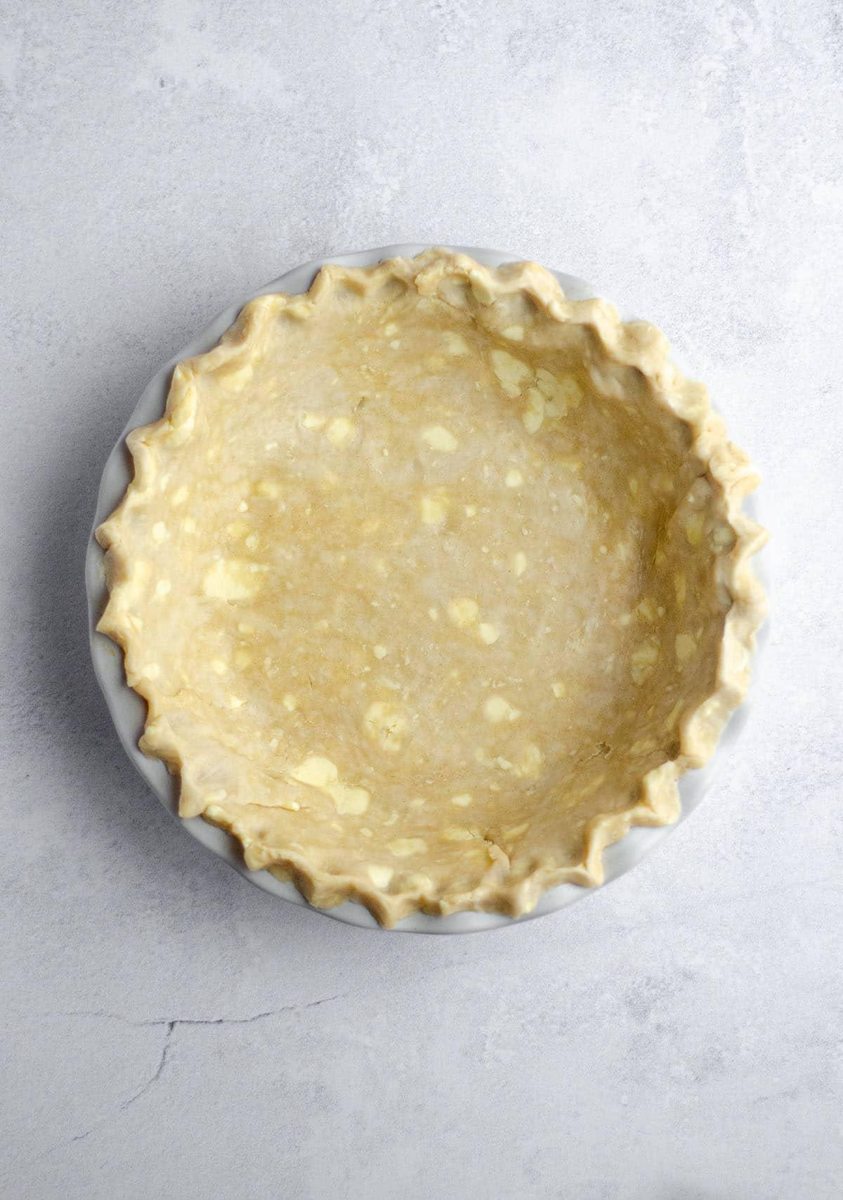 aerial photo of pie crust sitting in a pie plate