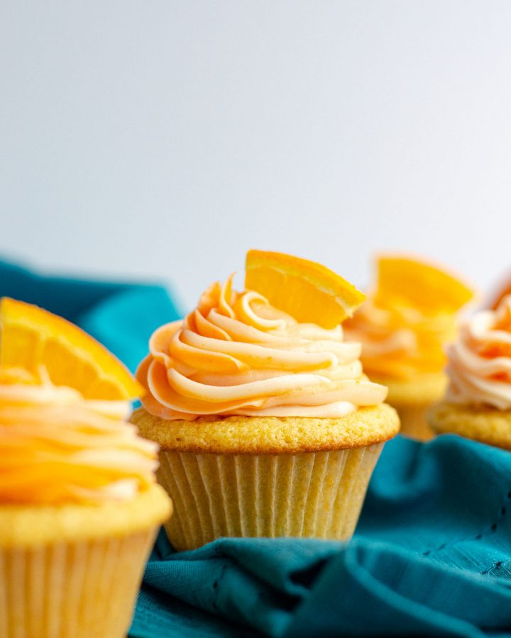 Orange Creamsicle Cupcakes: Simple orange cupcakes topped with swirls of orange and cream cheese frostings.