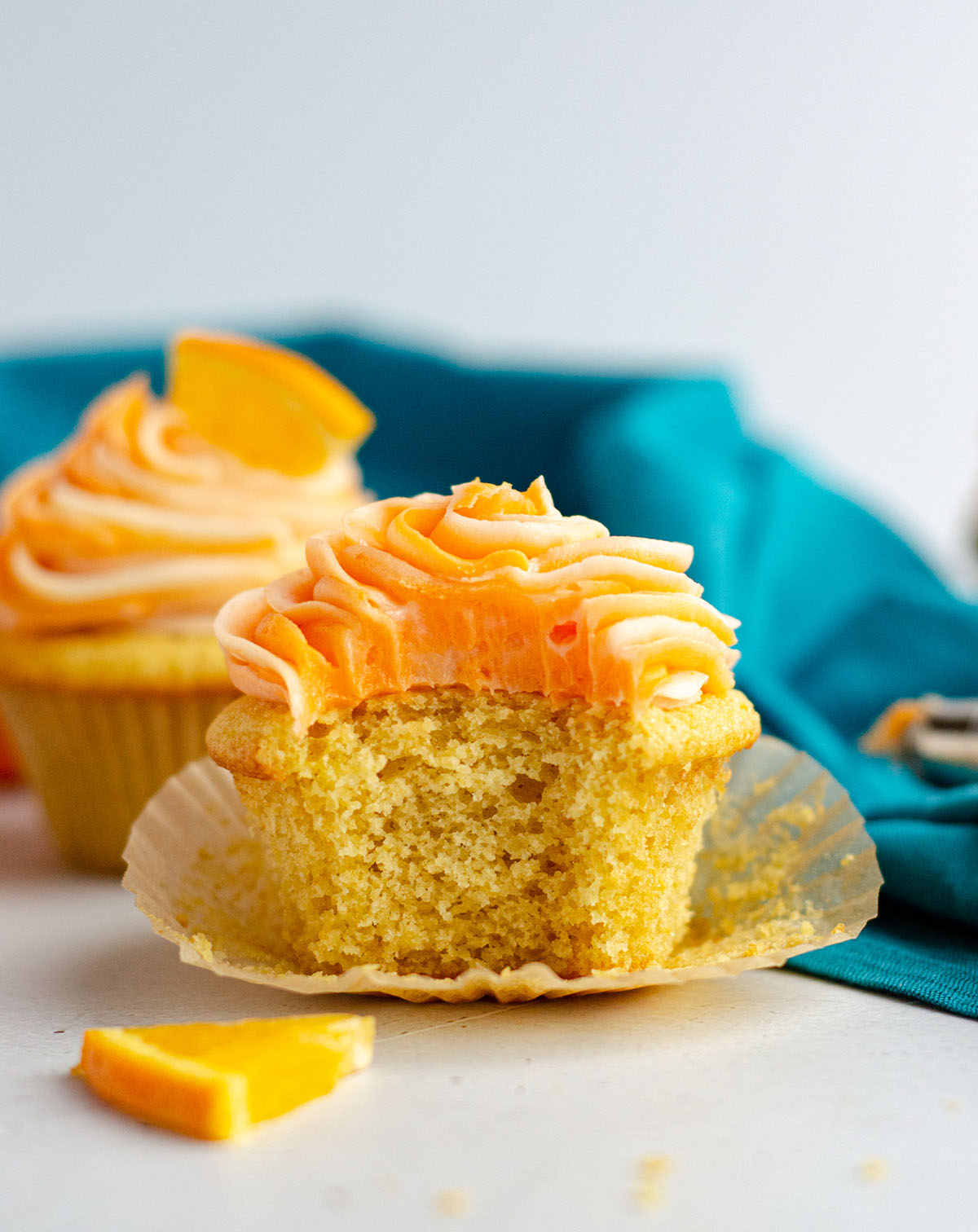 orange creamsicle cupcake with a bite taken out of it