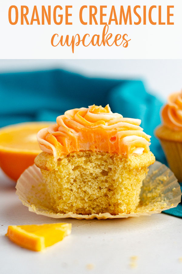 Simple orange cupcakes topped with swirls of orange and cream cheese frostings.