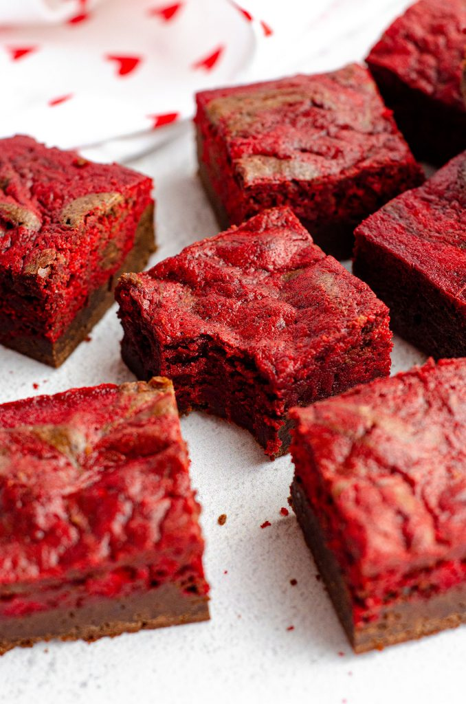Red Velvet Brownies: Dense and fudgy brownies swirled with red velvet cake-- everything is made from scratch!