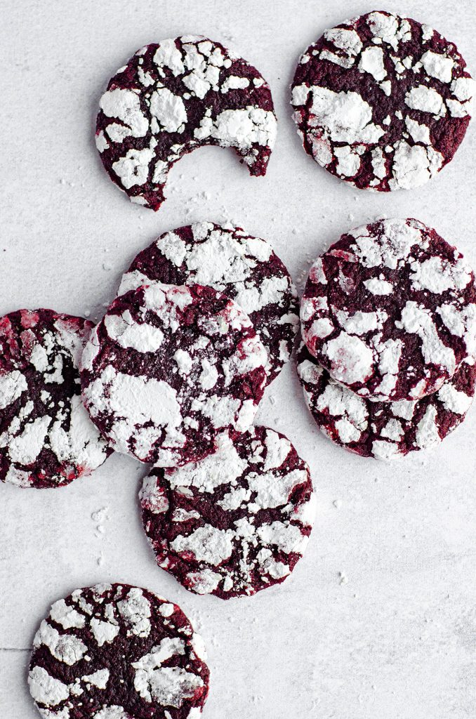 Red Velvet Crinkle Cookies: Soft and chewy red velvet cookies covered in crackled powdered sugar. No box mix required– they're made completely from scratch!