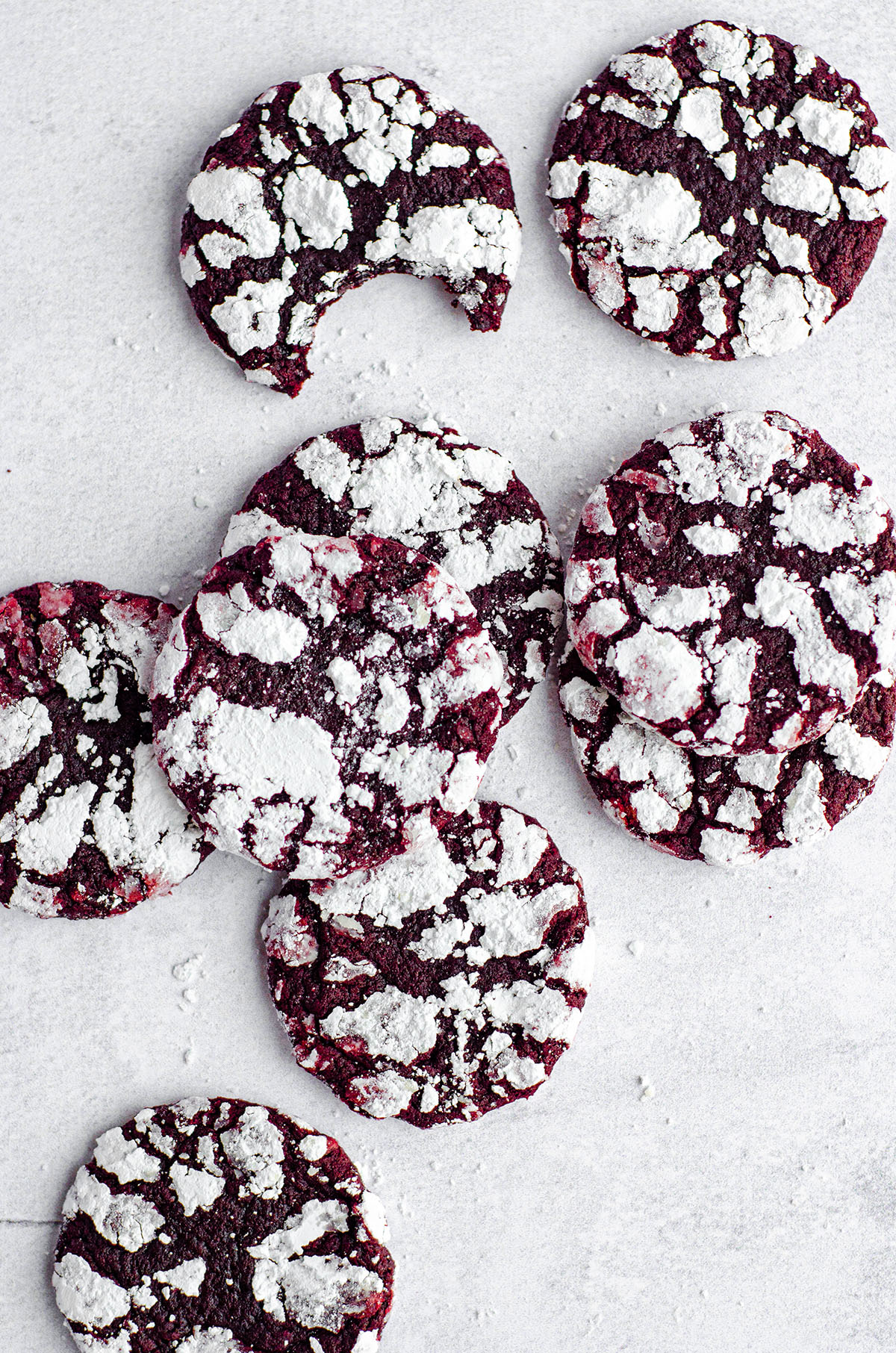 Soft and chewy red velvet cookies covered in crackled powdered sugar. No box mix required– they're made completely from scratch!