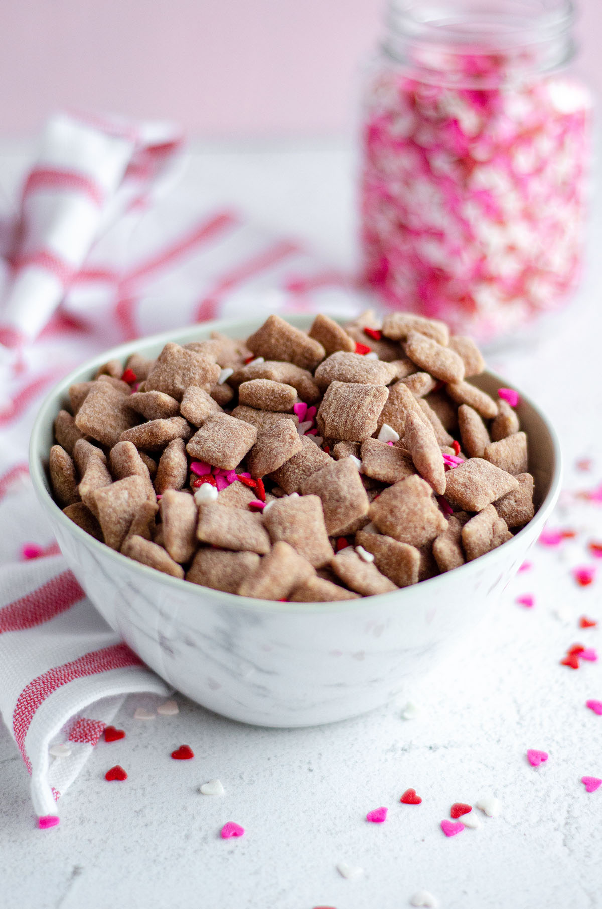 red velvet puppy chow in a white bowl