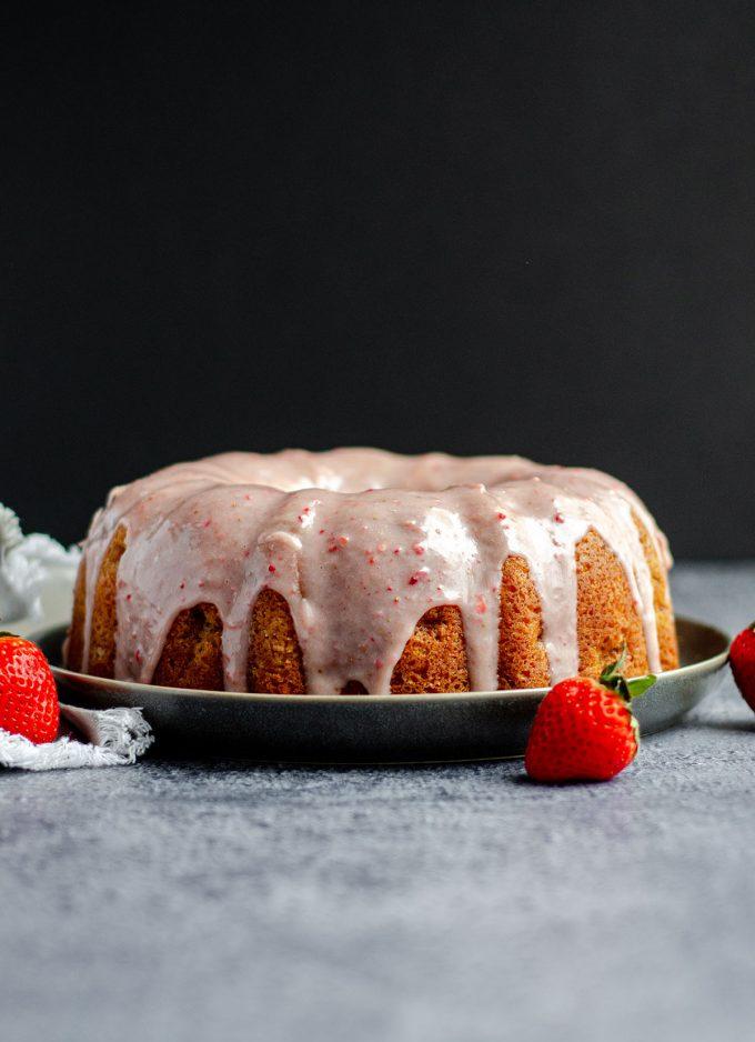 Strawberry Bundt Cake with Strawberry Ganache: Homemade strawberry bundt cake made from scratch with fresh strawberries and topped with strawberry white chocolate ganache.