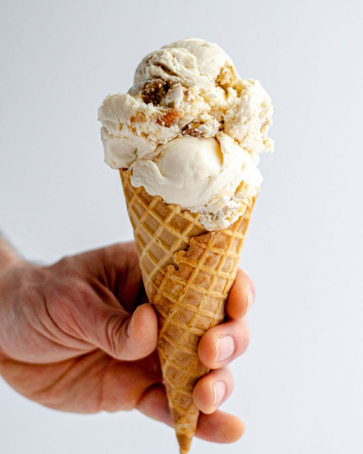 Praline Ice Cream: An easy homemade vanilla ice cream base swirled with salted caramel sauce and crunchy pecan praline pieces.