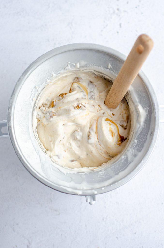 Praline Ice Cream: An easy homemade vanilla ice cream base swirled with salted caramel sauce and crunchy pecan praline pieces.