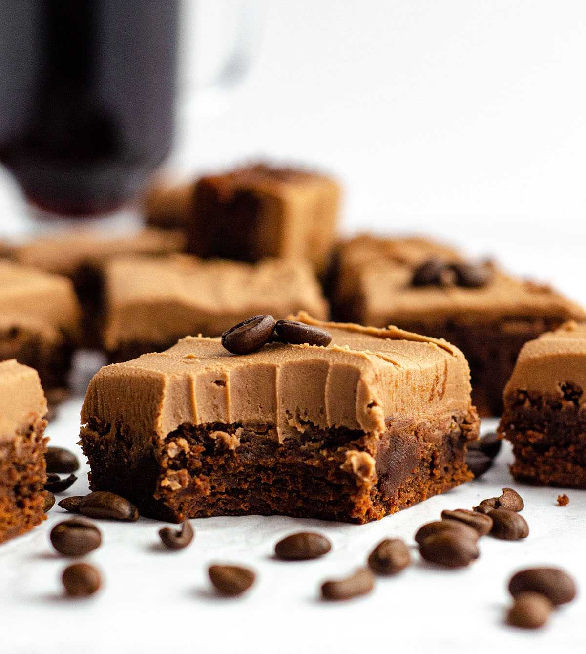 coffee brownie with mocha frosting with a bite taken out of it