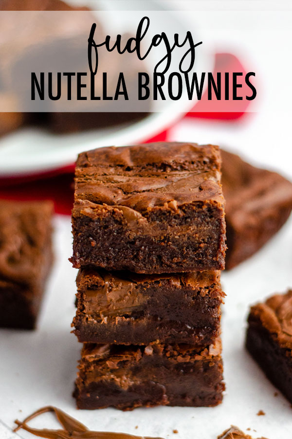 These seriously dense and fudgy Nutella brownies have Nutella blended right in the batter and swirled into the top. They are a chocolate lovers' dream!