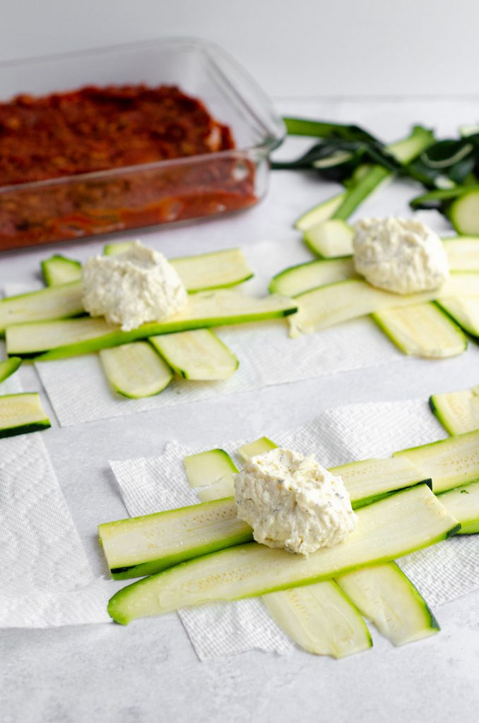 Zucchini Ravioli: Traditional ravioli get a vegetable makeover-- use zucchini in place of pasta for a gluten free, keto, or low carb ravioli substitute. These simple zucchini ravioli bring all the flavor and filling without the noodles!