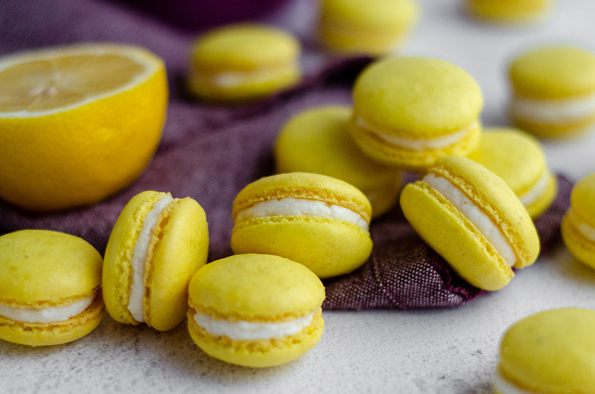 lemon macarons on a purple kitchen towel