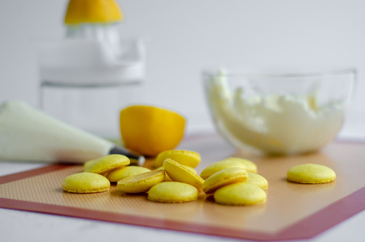 lemon macarons ready to assemble with frosting