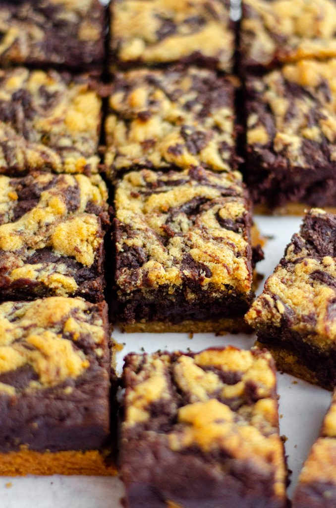 Peanut Butter Cookie Brownies: Soft and chewy brownies sit atop a peanut butter cookie crust and get swirled with peanut butter cookie batter to create peanut butter brownies unlike any other!