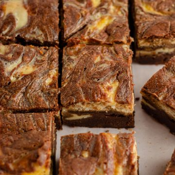 Tiramisu Brownies: These tiramisu brownies are made with a scratch brownie base, a middle layer of coffee-soaked Ladyfingers, and a top layer of sweetened mascarpone cheese.