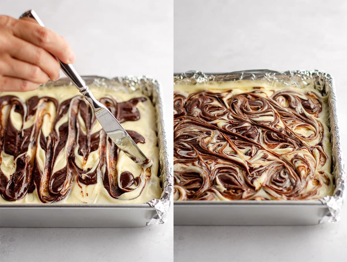 a hand swirling brownie batter into mascarpone cheese layer to make tiramisu brownies