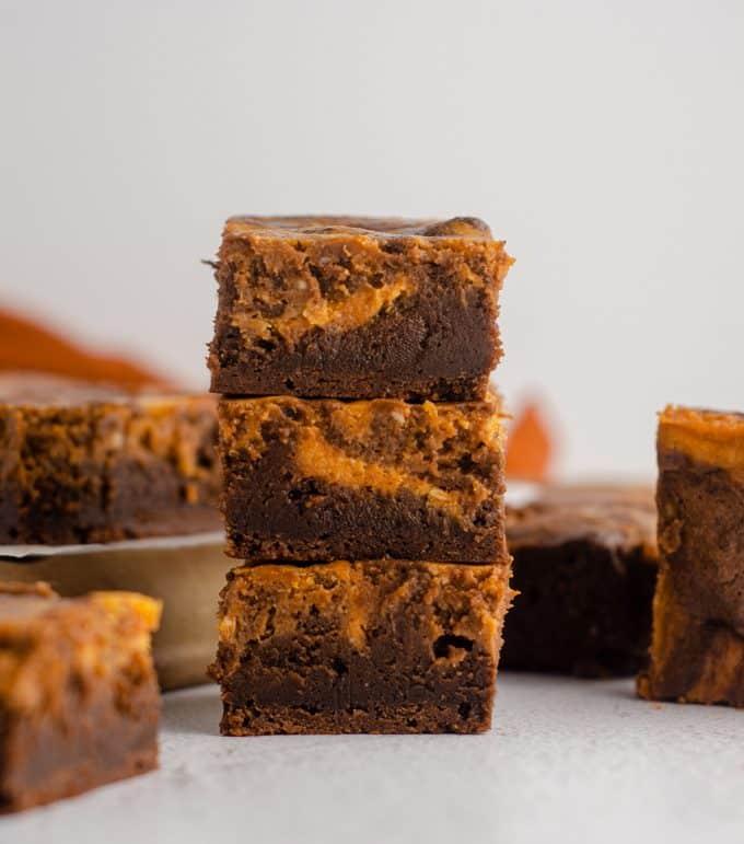 Pumpkin Cheesecake Brownies: Fudgy scratch brownies swirled with creamy pumpkin cheesecake.