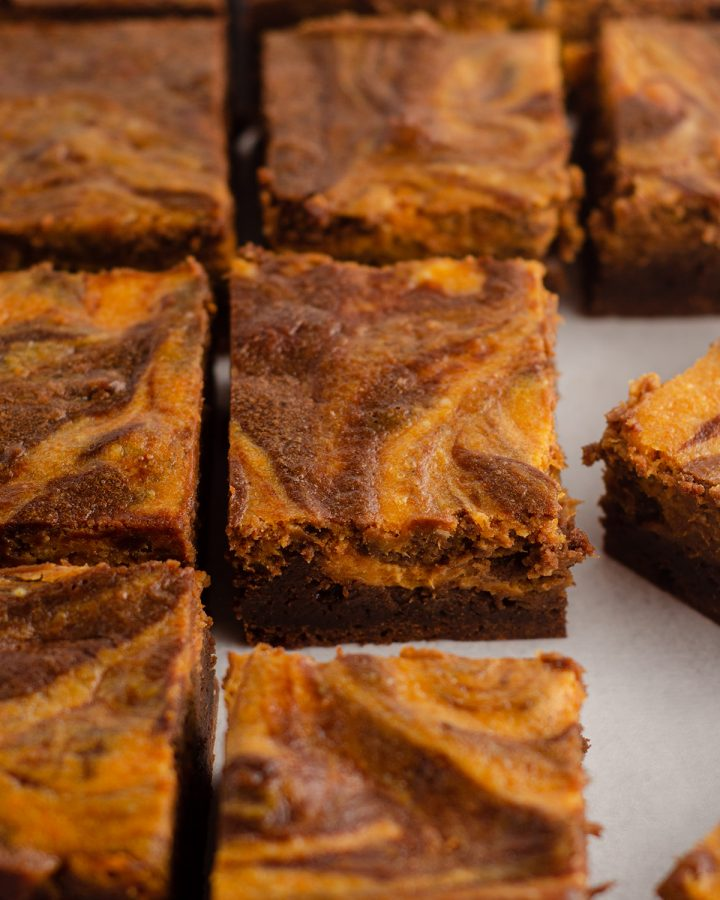 Pumpkin Cheesecake Brownies: Fudgy scratch brownies swirled with creamy pumpkin cheesecake.