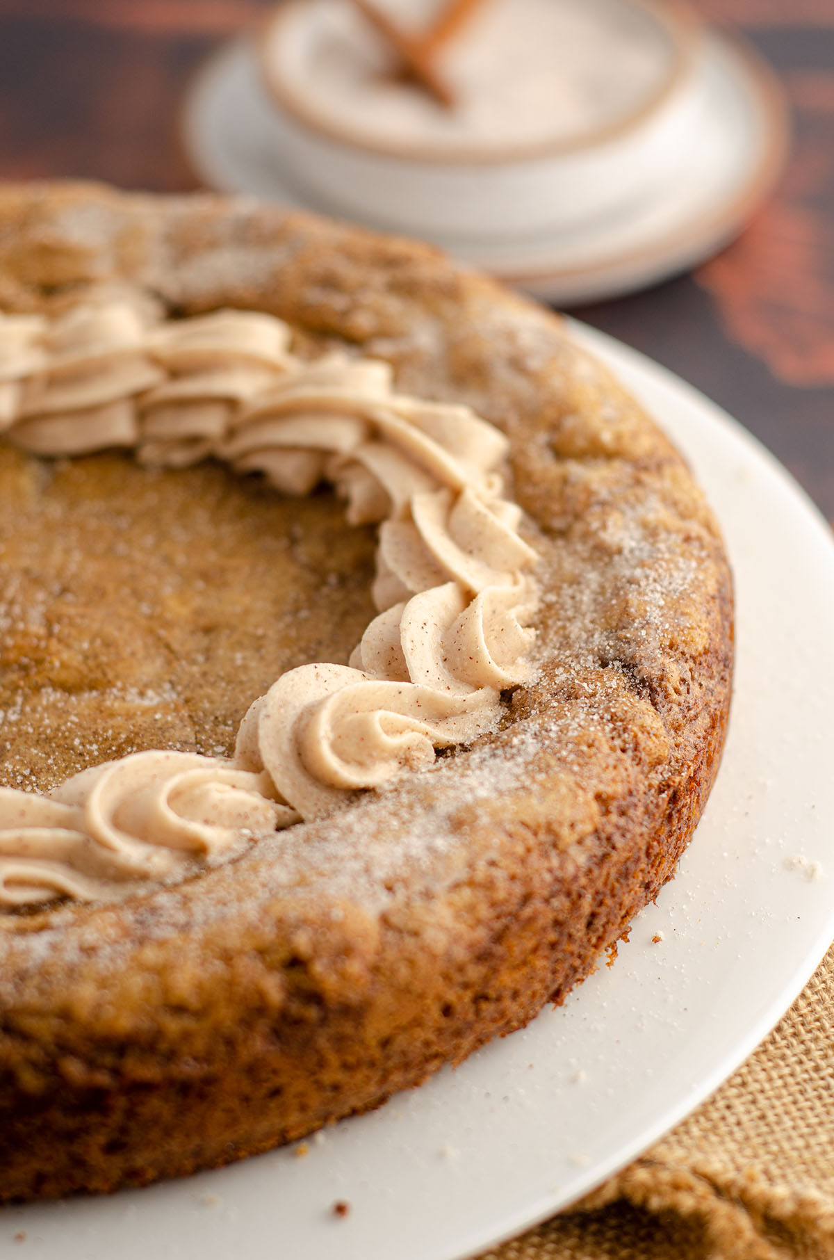 snickerdoodle cookie cake sitting on a plate