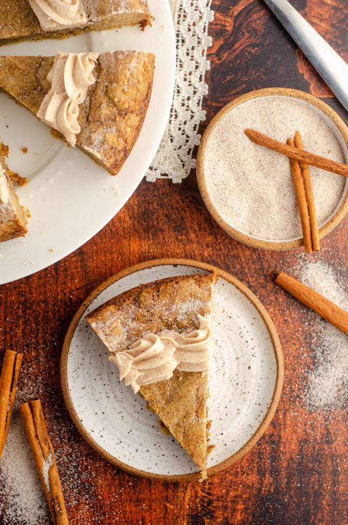 Snickerdoodle Cookie Cake: A simple brown sugar cookie base swirled with cinnamon ribbons and topped with a creamy, spiced snickerdoodle buttercream. Whip up one giant snickerdoodle cookie for your next celebration!