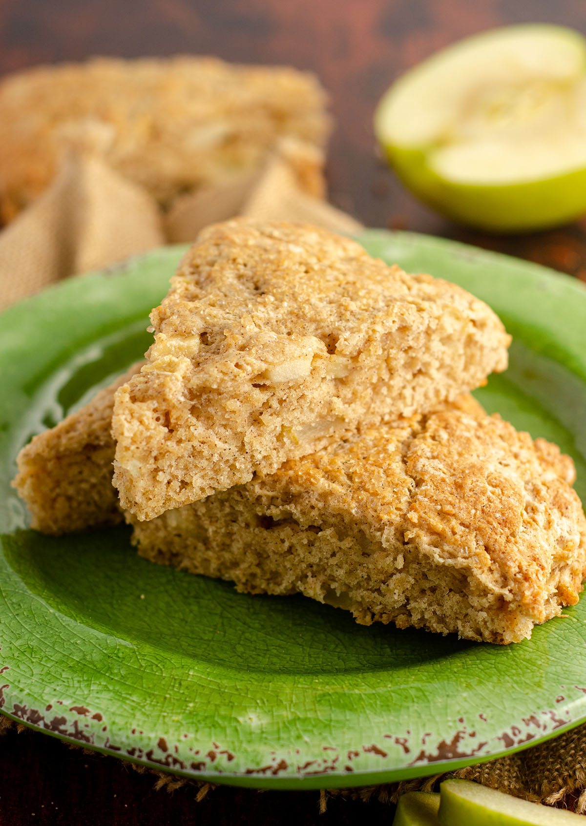 three apple scones piled up on a green plate