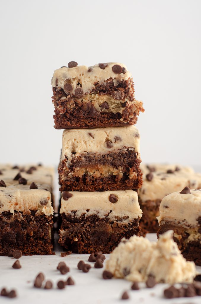 stack of 3 cookie dough brownies with cookie dough buttercream