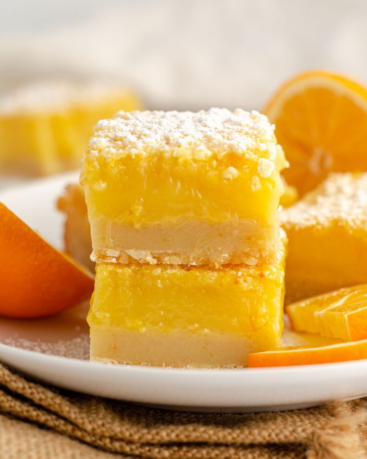 stack of meyer lemon bars with slices of meyer lemon
