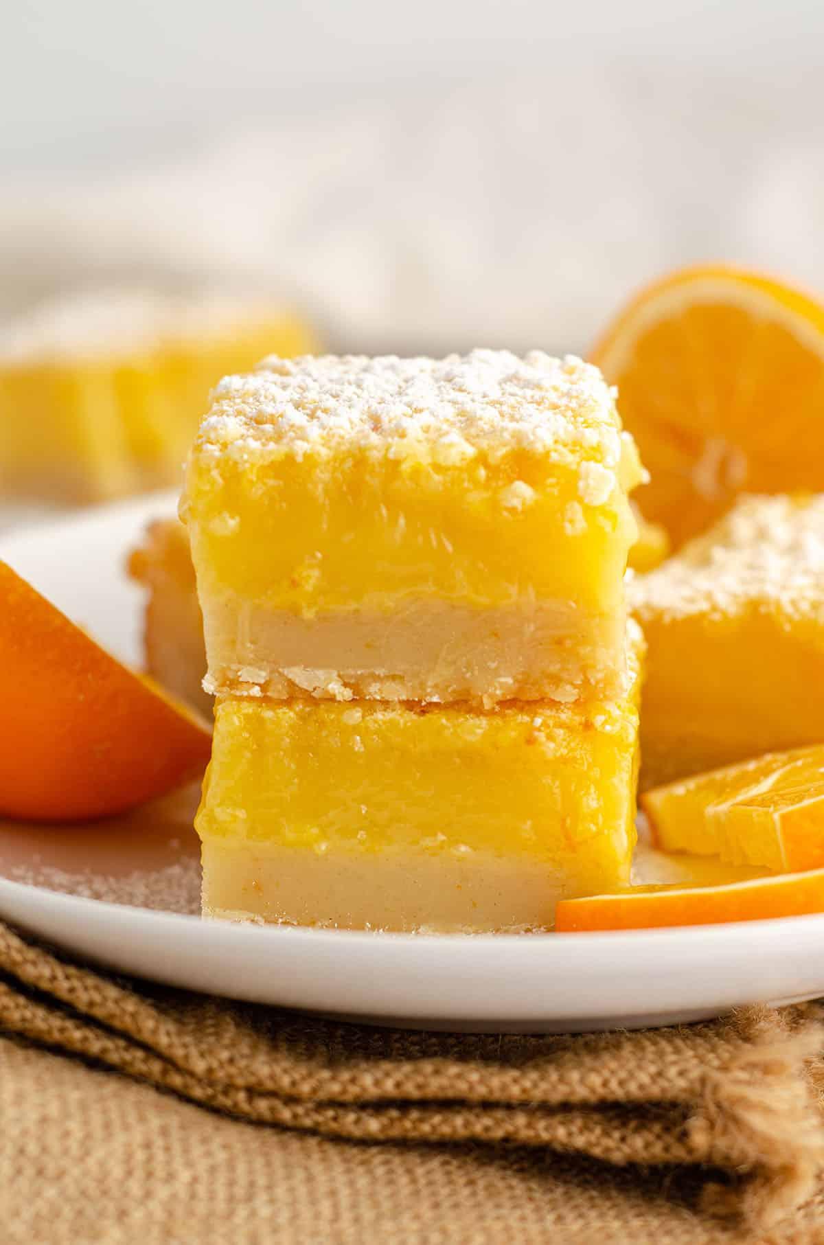 stack of meyer lemon bars with slices of meyer lemon