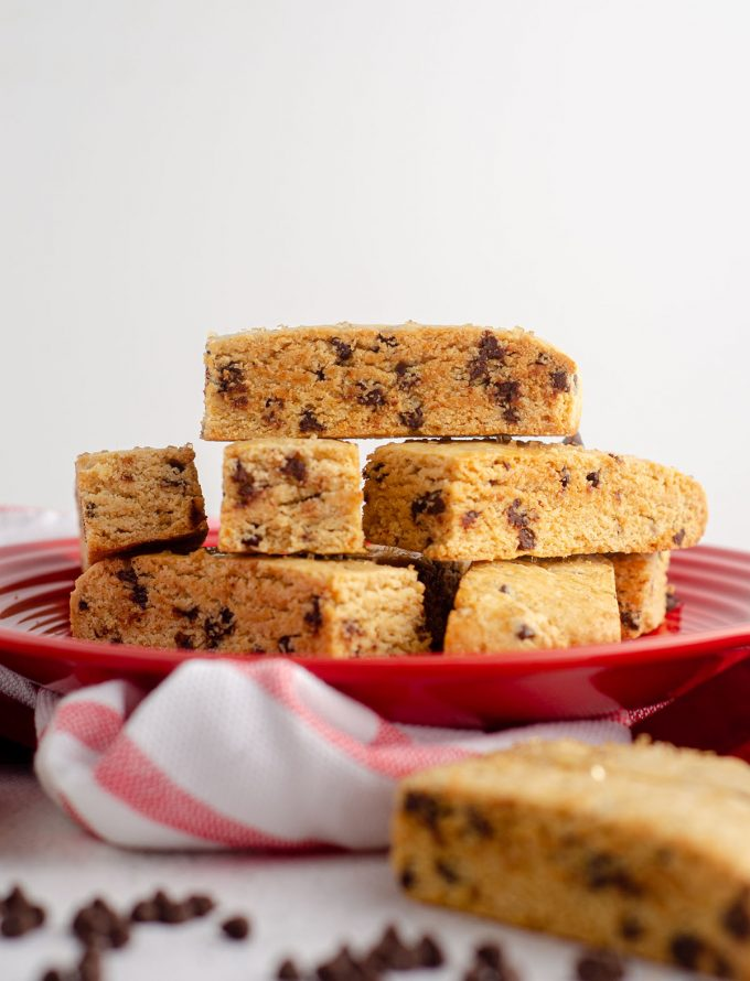 chocolate chip biscotti stacked on a red plate