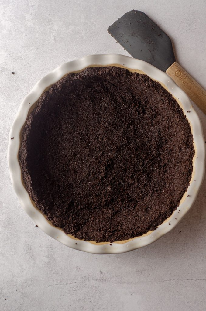 aerial photo of oreo pie crust in a pie plate