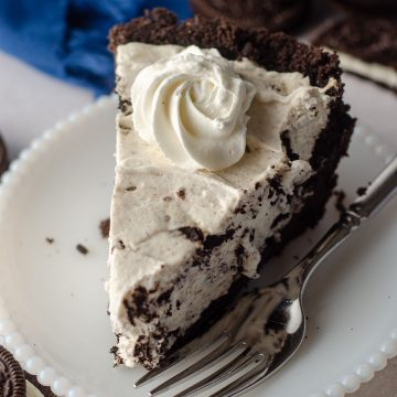 slice of no bake oreo pie sitting on a plate with a fork