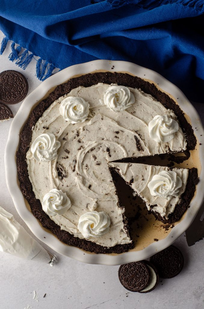 aerial photo of no bake oreo pie sliced and in a pie plate ready to serve