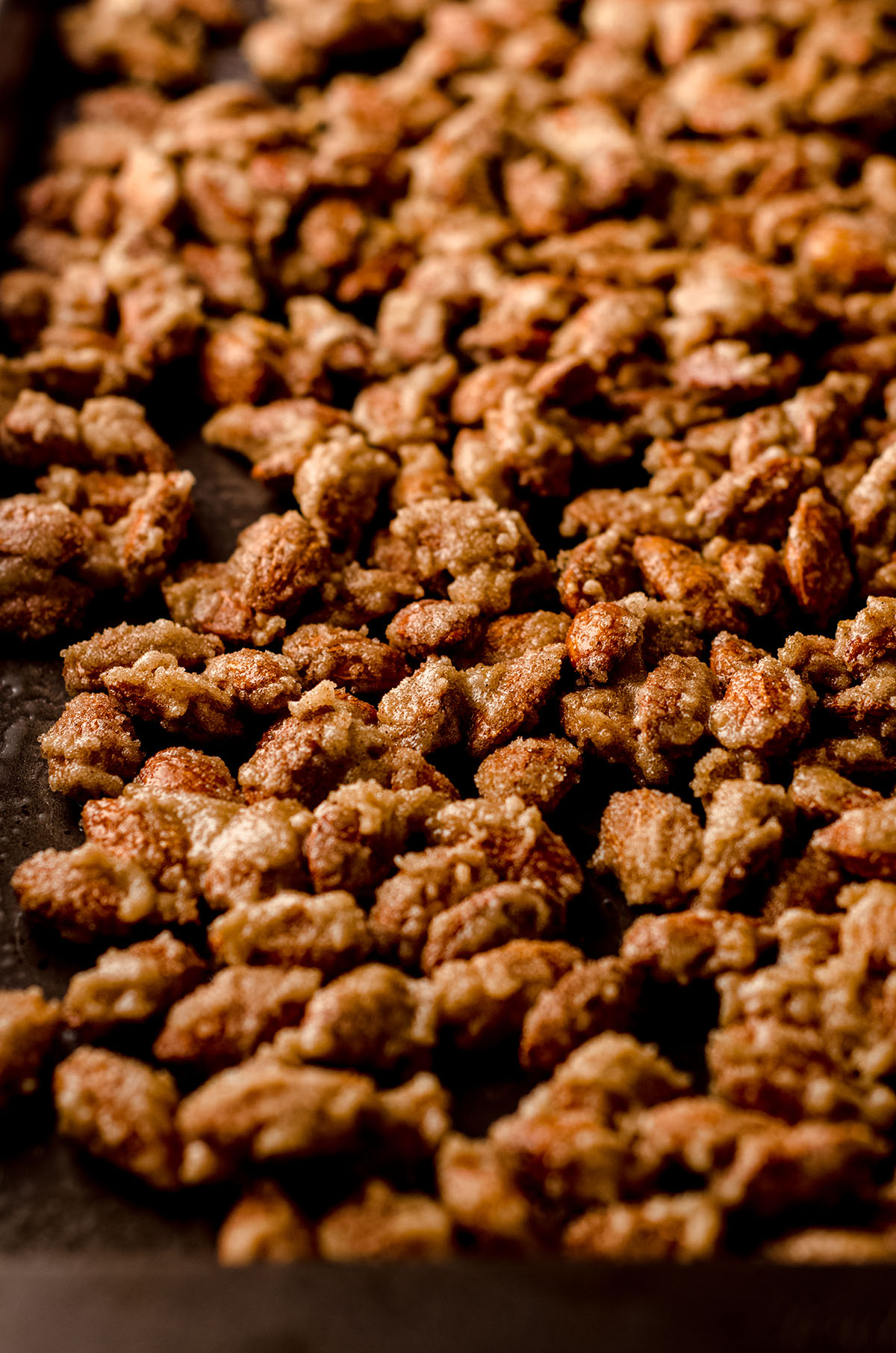 candied almonds on a baking sheet before baking