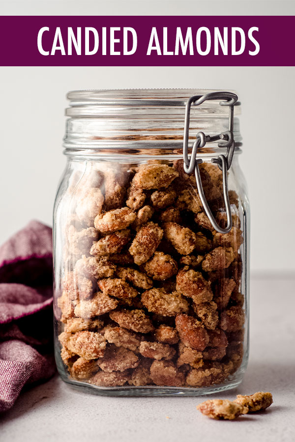 These easy oven baked candied almonds are flavored with vanilla and cinnamon for a sweet, salty, and crunchy exterior, perfect for topping salads or ice cream sundaes or simply snacking.