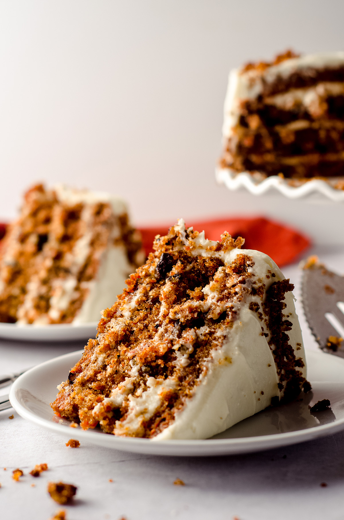 slice of carrot walnut cake on a white plate