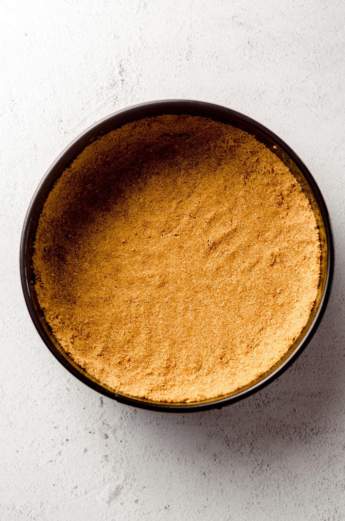 graham cracker crust in a springform pan