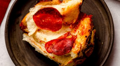 slice of pizza pull apart bread on a plate