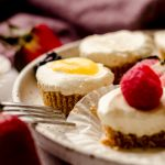 mini no bake cheesecakes on a plate with a fork