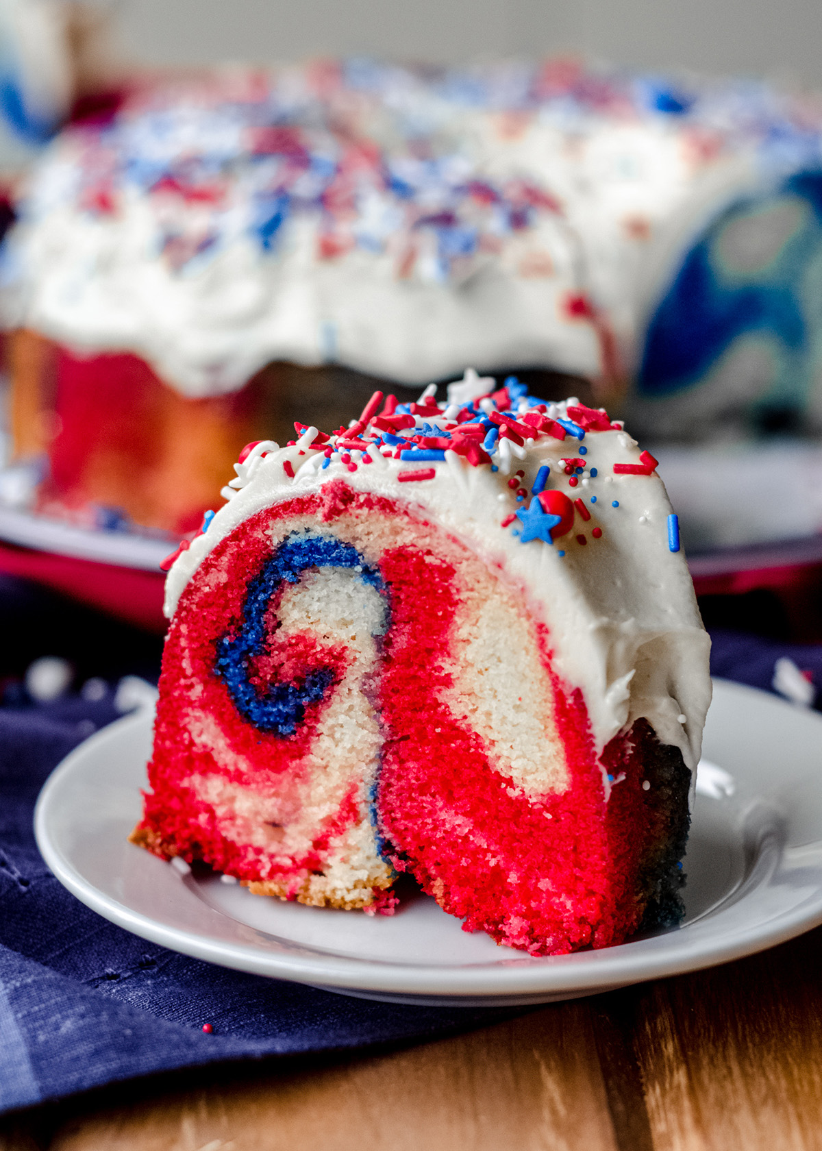 slice of red white and blue swirl cake on a plate