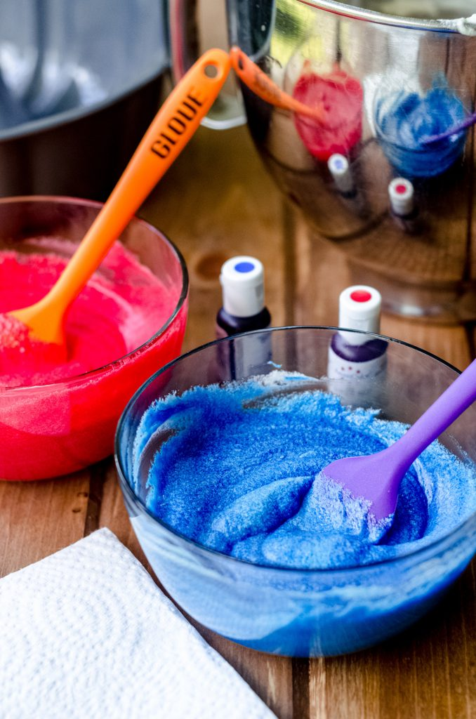 blue and red cake batter for a red white and blue swirl bundt cake