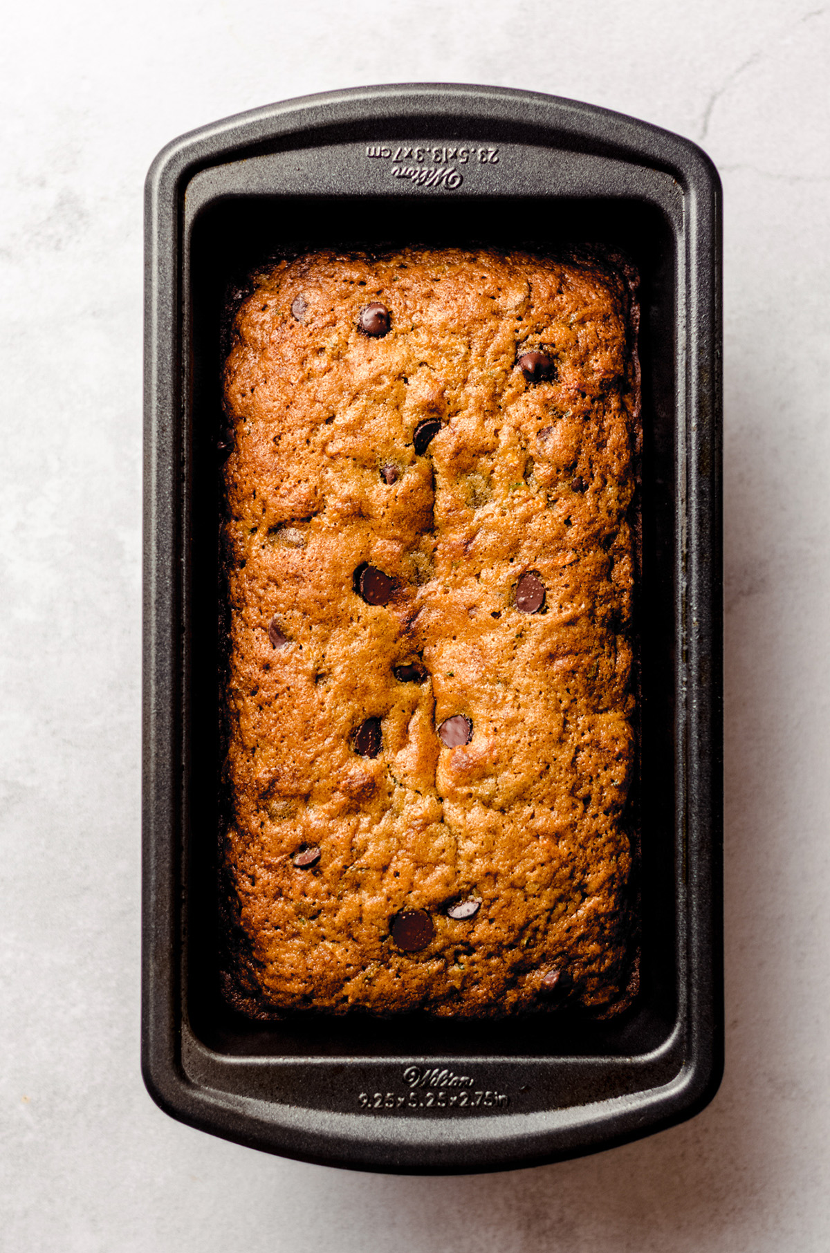 chocolate chip zucchini bread in a loaf pan