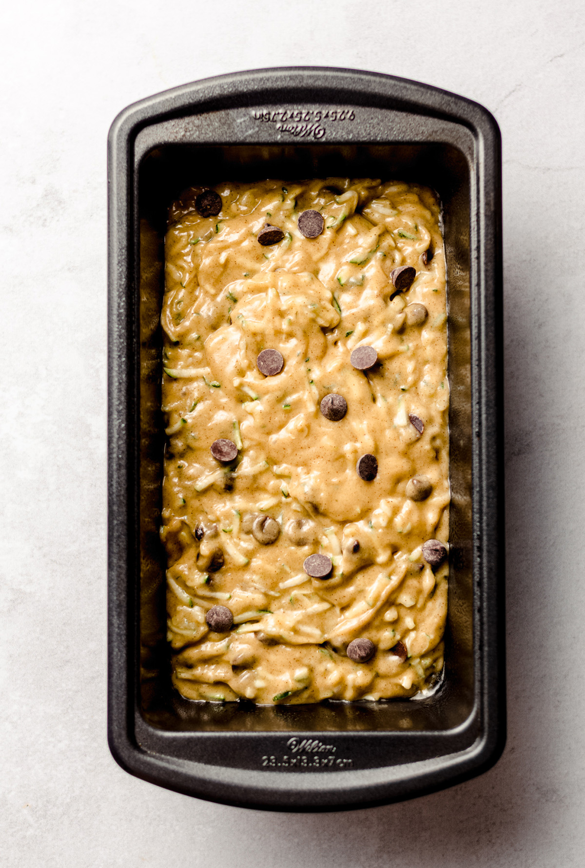 chocolate chip zucchini bread batter in a loaf pan
