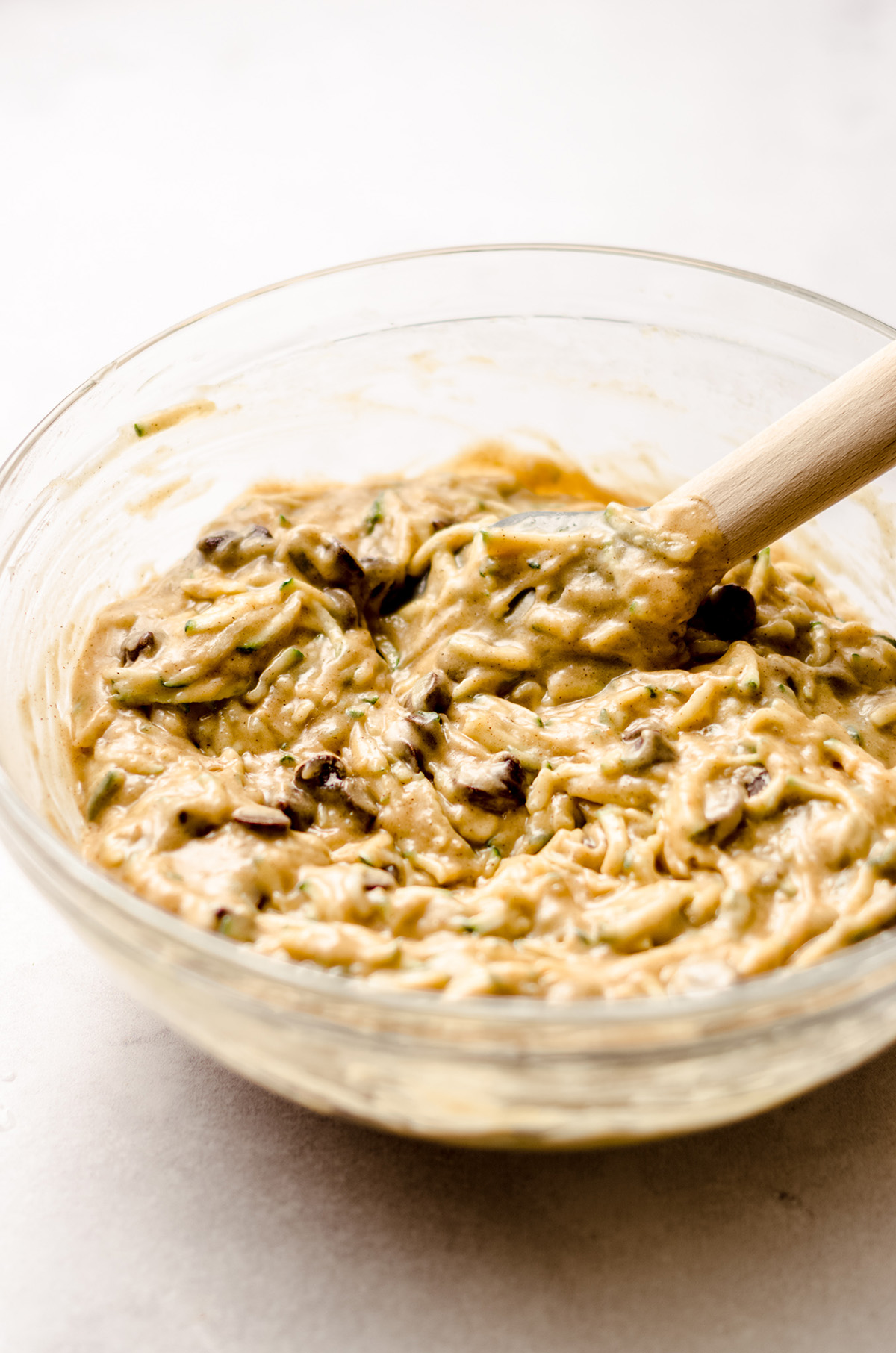 chocolate chip zucchini bread batter in a glass bowl